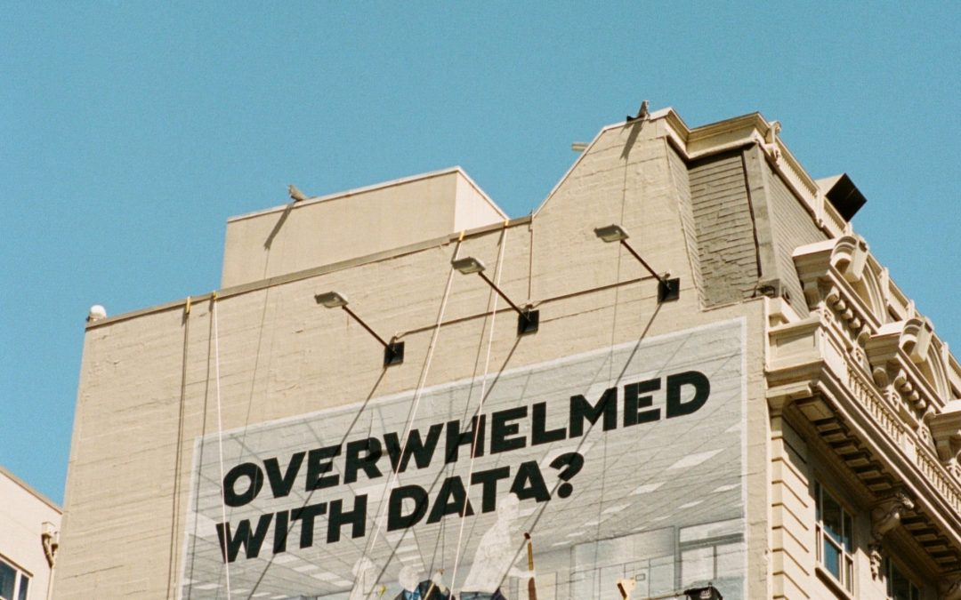 """a billboard that says """"overwhelmed with data?"""""""